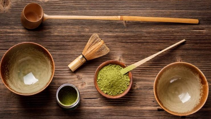 Set for making matcha tea on vintage wooden background